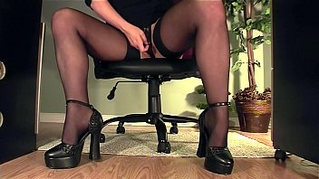 Clothed secretary sucking cock